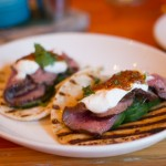 La Condesa Tacos Arabicos: seared venison, pickled cucumber, chipotle harissa, fennel pollen yogurt, cilantro, bacon fat tortilla